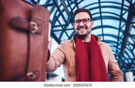 Happy businessman with a bag in front of the corporation. Business, education, lifestyle concept