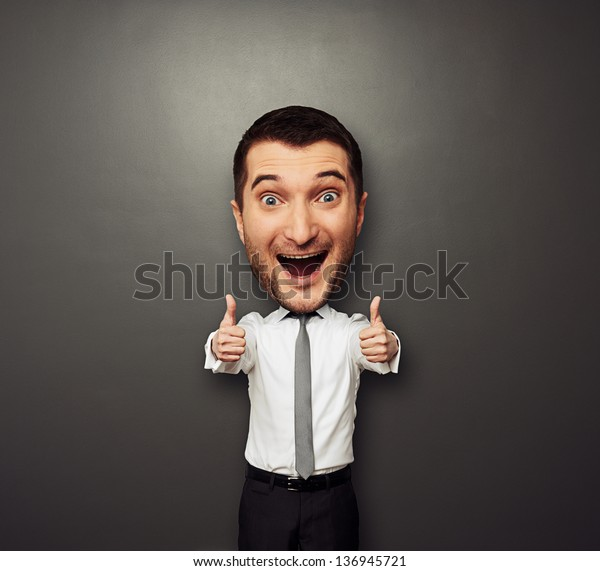 happy businessman with big head showing two thumbs up and laughing. funny picture over dark background