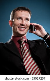 happy businessman calling by phone over blue