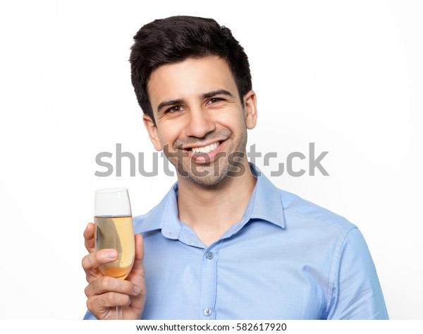 Happy businessman drinking champagne