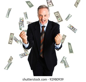 Happy businessman enjoying a rain of money