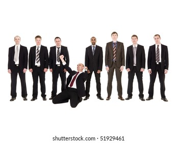 Happy businessman in front of his team isolated on white background