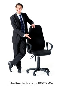 Happy businessman gestures to an empty seat, a recruitment concept