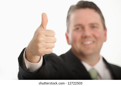 Happy businessman giving thumbs up, DOF focus on hand