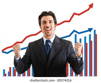 Happy businessman with a growing graph in the background