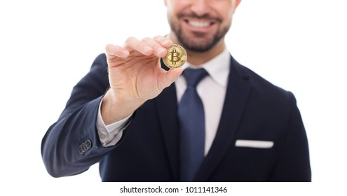 Happy businessman holding bitcoin coin closeup, isolated on white background