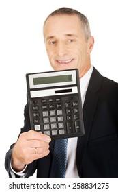 Happy businessman holding a calculator.
