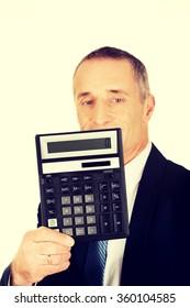 Happy businessman holding a calculator