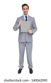 Happy businessman holding a clipboard on white background