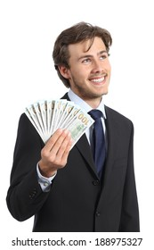 Happy businessman holding money and looking sideways isolated on a white background