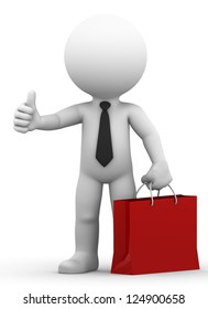 A happy businessman holding shopping bag and giving thumb up. Isolated on white background