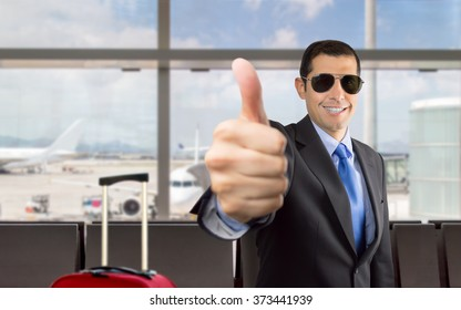 Happy businessman holiday travel at the airport