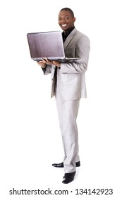 Happy businessman with laptop. Isolated on white