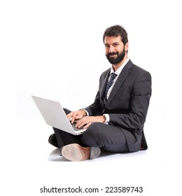 Happy businessman with laptop over isolated white background