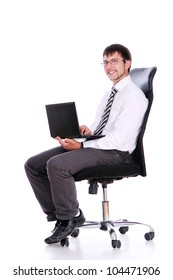 Happy businessman on chair with laptop over white background