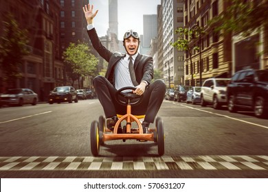 Happy Businessman on a pedal car