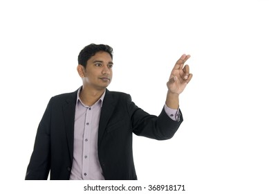 happy businessman pointing at copy space