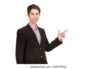 Happy businessman pointing his finger up in the brown suit on a white background