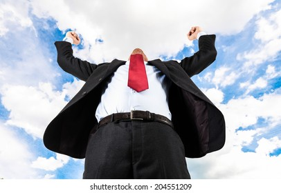 Happy businessman raising his arms