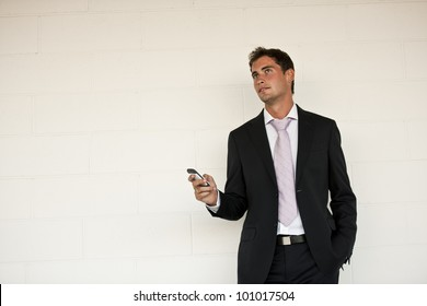 Happy businessman speaking on the cellphone