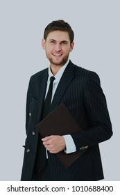 Happy businessman standing looking at camera, smiling. Isolated on white background.