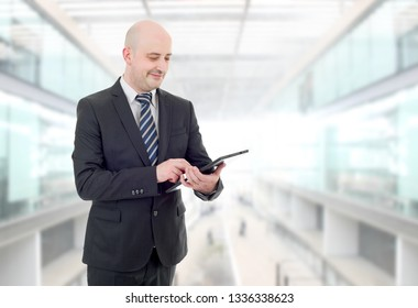 happy businessman with a tablet pc, at the office