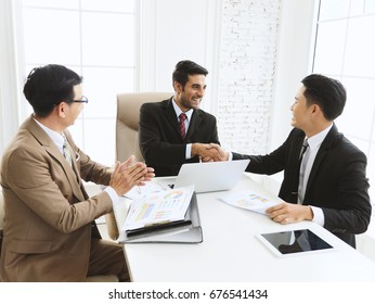 Happy businessman team meeting at modern office and shaking hand with business partners.