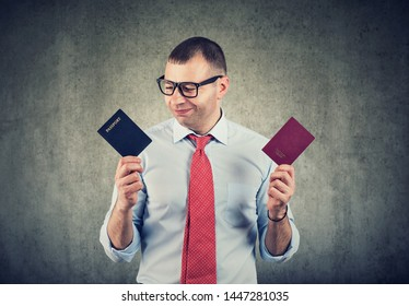 Happy businessman with two passports, dual citizenship