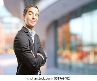 Happy businessman winking an eye