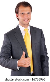 Happy businessman in a yellow tie showing thumb up
