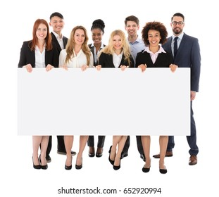 Happy Businesspeople Holding Billboard Over White Background