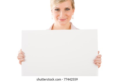 Happy businesswoman with blank advertising banner on white