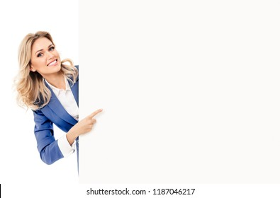 Happy businesswoman in blue confident suit, showing blank signboard with copyspace empty area for slogan or advertise text, isolated against white background. Blond model in business concept.
