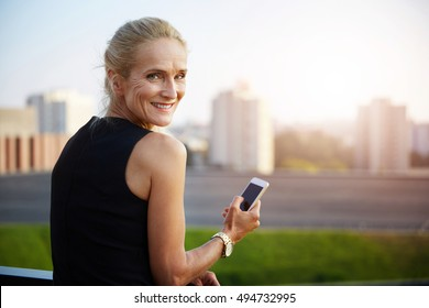 Happy businesswoman with city view in background