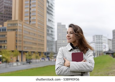 happy businesswoman with digital tablet in the city