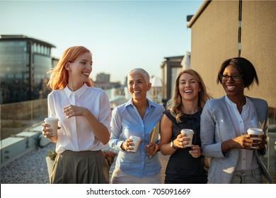 Happy businesswoman having a coffee break together.