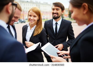 Happy businesswoman looking at her colleague during conversation