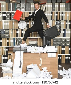 Happy Businesswoman at a messy office