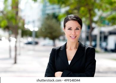 Happy Businesswoman on downtown street