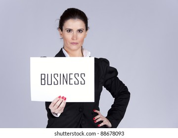 Happy businesswoman showing a paper with the word Business