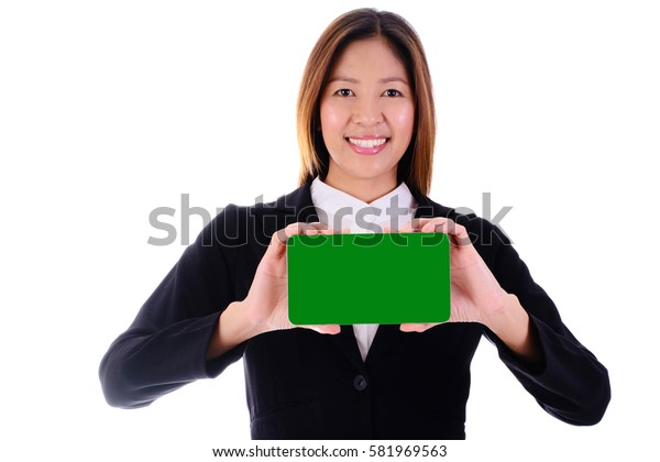 Happy businesswoman smiling and holding green banner on white background.
