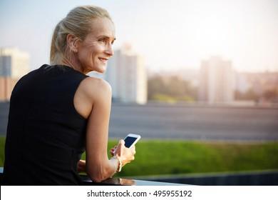 Happy businesswoman texting