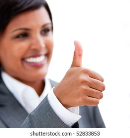 Happy businesswoman with a thumb up against a white background