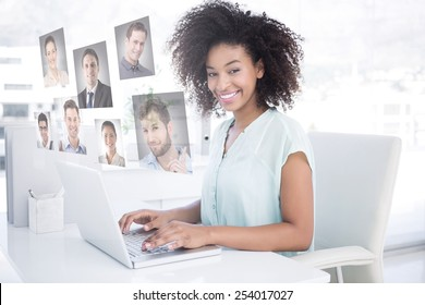Happy businesswoman working on her laptop against profile pictures