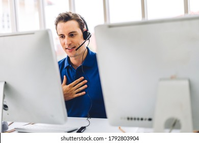Happy call center smiling businessman operator customer support consult phone services agen working with wireless headset microphone and computer at call center office