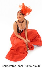 Happy cancan dancer tired sitting on the floor