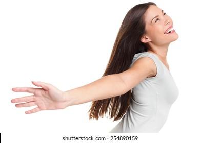 Happy carefree joyful elated woman praising joyful elated woman with arms raised outstretched smiling joyful and ecstatic full of happiness with eyes closed isolated on white background in studio.