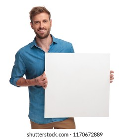 happy casual man holding a blank message on white bakground