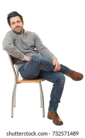 happy casual man on a chair, isolated on white background