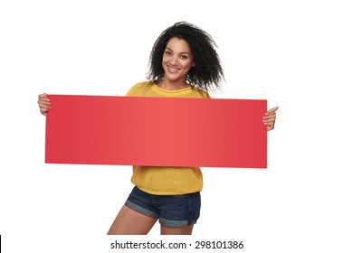 Happy casual mixed race african american - caucasian woman holding blank red banner, over white background